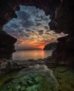 sunrise inside a cave at bruce peninsula national park
