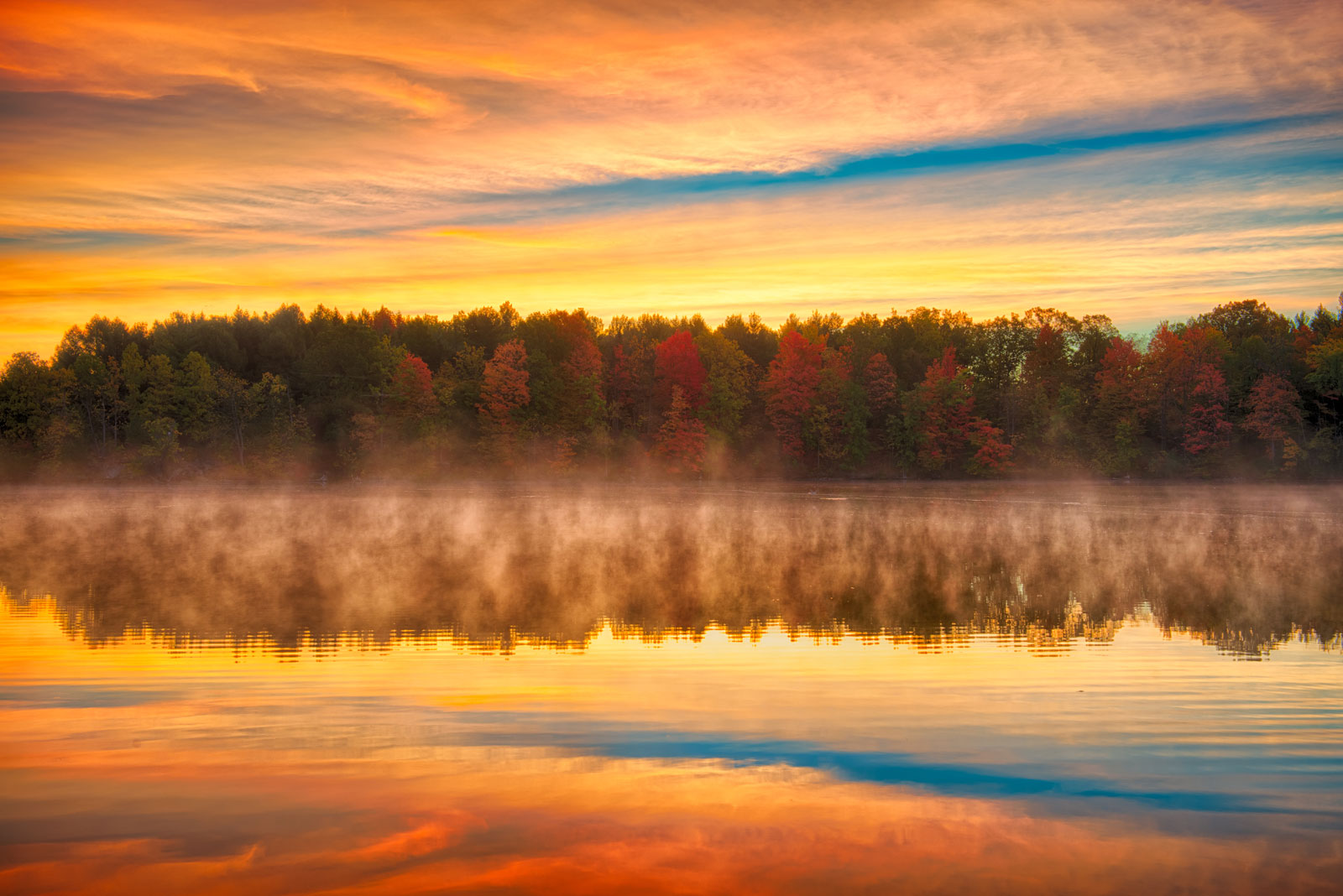 sunrise over misty lake in fall