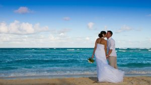 newly wed first kiss beach wedding