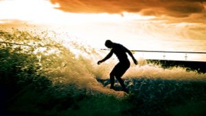 impressionist picture of man surfing