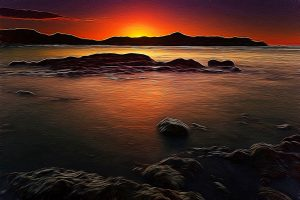impressionist image of rocks sunset