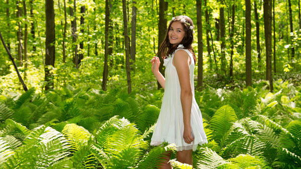 portrait-of-teen-in-lush-green