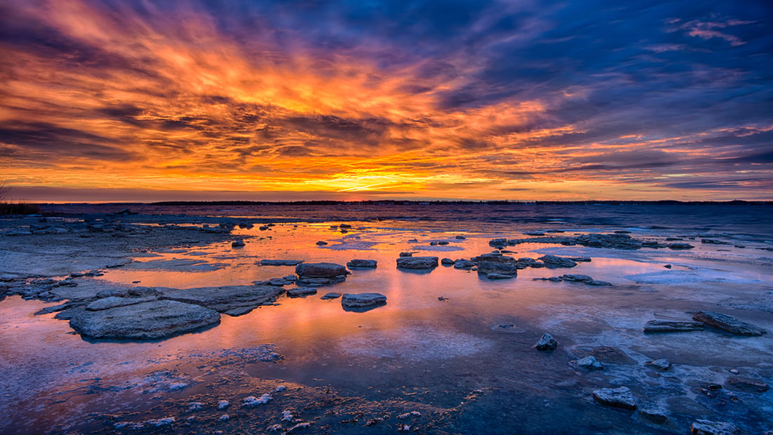 Rise Over Icy Lake