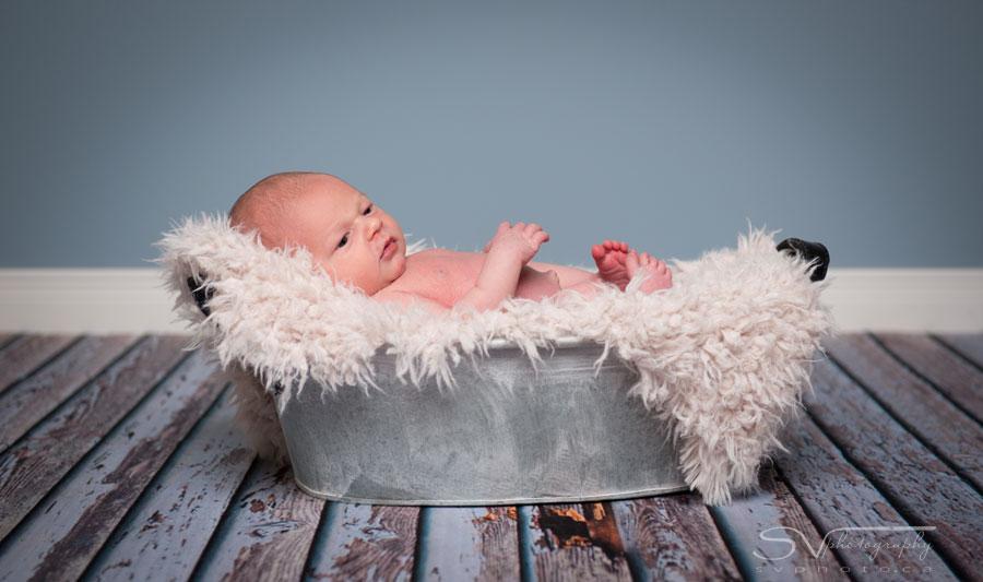 newborn in wash basin