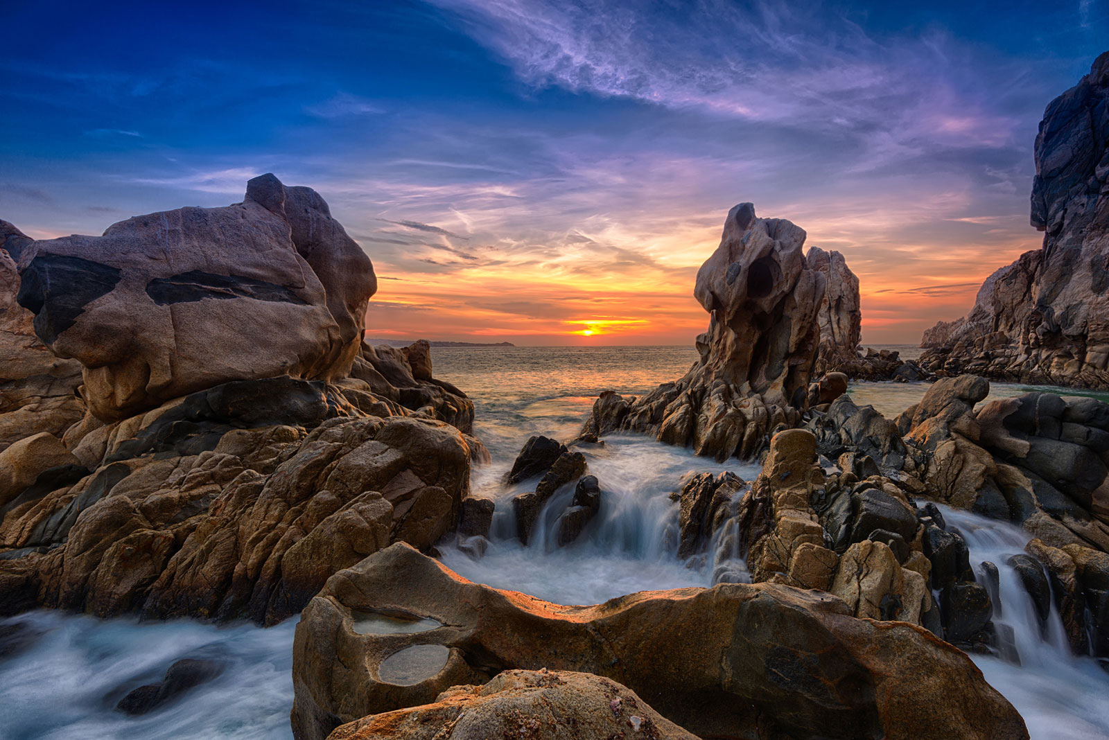 unearthly rock formations dramatic sky sunrise cabo
