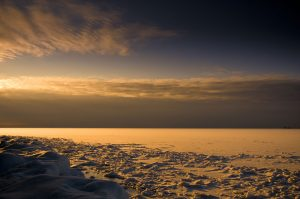 frozen lake in winter snowscape