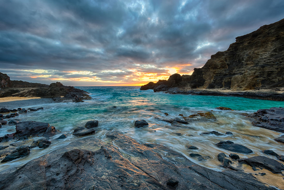 """Halona Cove"" The large rock in the middle of the beach was perfect focal point for this sunrise image. Purchase a print of this image in the shop."
