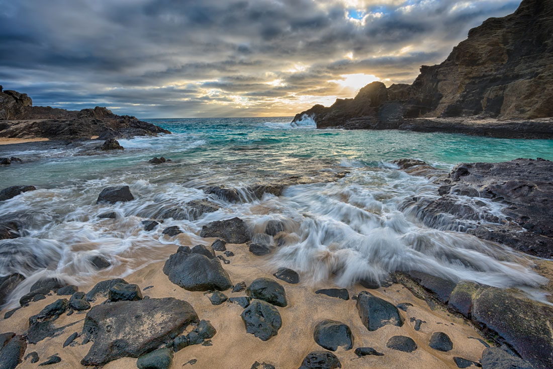 """""""Incoming"""" The movement of the surf coming over the rocks and onto the beach at Halona Cove at sunrise. Purchase a print of this image in the shop."""